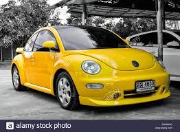 volkswagen buggy yellow vivid yellow modern volkswagen vw beetle motorcar against a black
