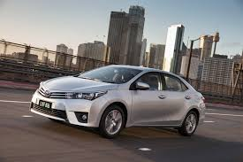 2014 toyota corolla sedan pricing and specifications photos 1