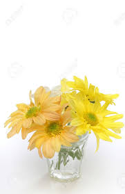 Yellow Glass Vase Group Of Flowers In A Glass Vase Yellow White And Orange Daisies
