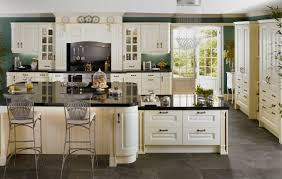 white kitchen cabinets with glass doors cabinets laminate wooden floor dark ceramic countertop two level