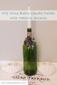 diy wine bottle candle holder with metallic accents setting for four