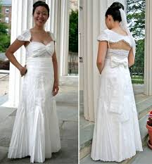 a flushing bride wears a gorgeous white wedding dress made of
