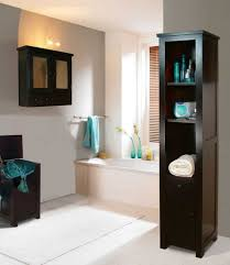 modern bathroom decor with chocolate brown cabinet and teal