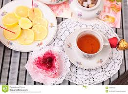 warm cup of tea heart shaped cake and sweets royalty free stock