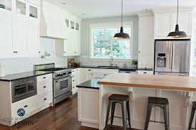 kitchen with black island and white cabinets the 4 best paint colours for kitchen island or lower