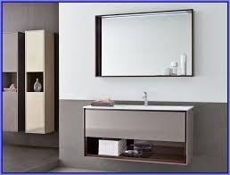 bathroom gray metal vanity with transparent glass side sink with
