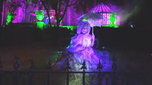 madame renata chats with panda at haunted mansion during mickey u0027s