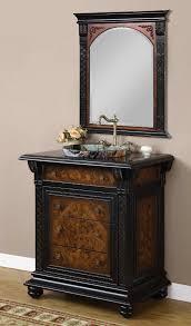 brown black wooden bathroom vanity with round stone sink on