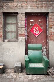 dusty china abandoned armchair in a dusty hutong kaifeng china stock photo