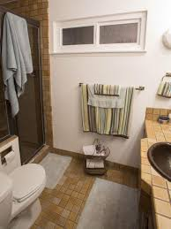 bathroom dark shower door white oval standard toilet light yellow