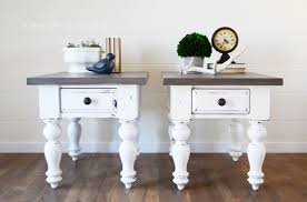 white farmhouse tables with weathered wood tops a ray of sunlight