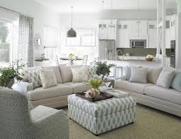 the gray carpet two white window blinds open concept living room