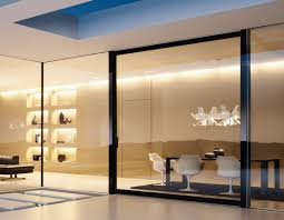 interior glass partition between dining space and living room with