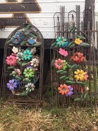 wrought iron colorful flower trellis vine growing yard art
