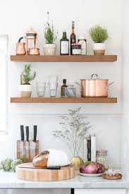 how to set up a kitchen crate and barrel blog kitchen counter with fresh bread and vegetables under wooden wall shelves
