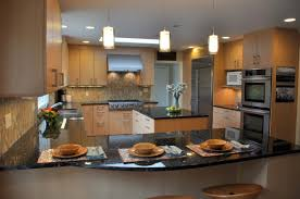 kitchen birch cabinets grey brick backsplash kitchen island eat