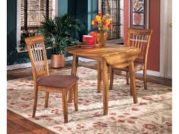 ashley dining room tables ashley dining room round drm drop leaf table d199 15 joe tahan s