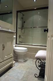 cream wall paint glass shower cabin door towelshelf mirror with