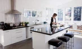 white kitchen cupboards black bench suspended medium kitchen island without sink kitchen