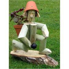 wooden garden bowling flowerpot with fresh plants