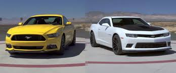 5 0 mustang vs camaro ss motor trend tries the ford mustang against the chevy camaro gm