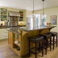 kitchen island bar height traditional kitchen with modern built in cabinetry in houston