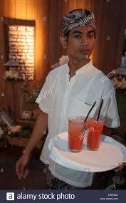 young woman man serve drinks indonesian waitress cocktails plate