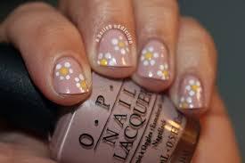 a polish addiction think spring dotted daisy nails
