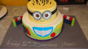 two tier round birthday cake buzz lightyear despicable me minion