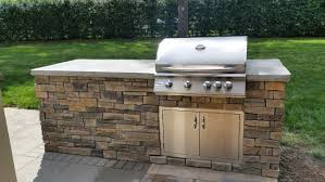 outdoor kitchen island kits 28 images 6 ft island kit outdoor kitchen kits outdoor kitchen concrete counter top with rock face built in grill summerset