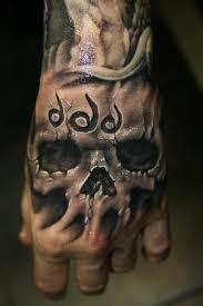tattoo hand design 35 awesome skull tattoo designs tattoo group pinterest