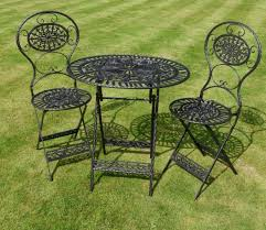 patio ideas rod iron patio furniture with iron material over green