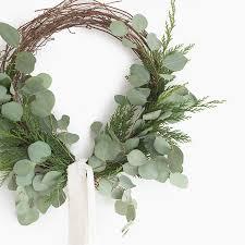 fresh cedar and eucalyptus wreath flowering winter plants