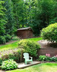 beautiful landscape design with romantic sitting area stock photo