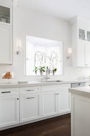 white shaker kitchen cabinets with gray quartz countertops white glazed brick tiles with light gray quartz countertops