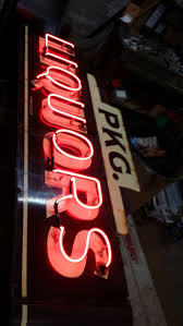 Liquor Signs Antique Shops Including Cabbages U0026 Kings Antique Mall And La Rose