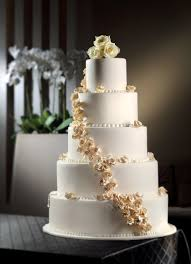 wedding cake hong kong five tier white cake delicately decorated with beige roses and