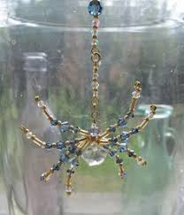 green blown glass spider beaded spider