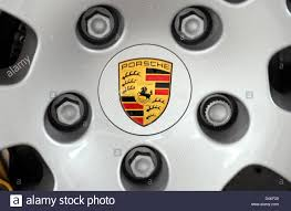 porsche wheels on vw the company logo on the wheels of a porsche panamera in stock