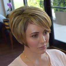 shorter hairstyles with side bangs and an angle 50 layered bob styles modern haircuts with layers for any occasion