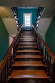 finish stairs to bat painted pipe handrail on wall at beginning of