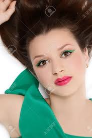 beautiful young in green dress with fresh makeup lying