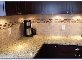 kitchen kitchen with u shaped countertop with dark brown cabinet