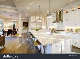 kitchen design with granite countertops white kitchen design features large bar stock photo 555911137