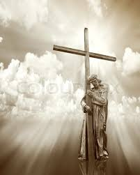 jesus holding a cross on cloud sepia background stock photo