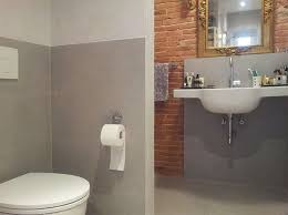 european bathroom design exposed brick and gray tile at home in