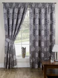 grey curtains and drapes decorate the house with beautiful curtains