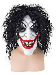 smiling man face mask with black hair joker batman halloween