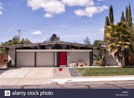 eichler house with red door on bright sunny day stock photo