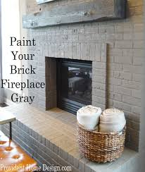 gray painted brick fireplace provident home design